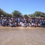 The church assembled and celebrating sixteen new Believers being Baptized in the ocean.