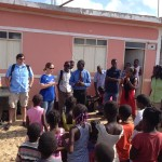 Cissy Smith sharing with children in the village