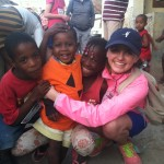 Hadyn sharing Christ with these children
