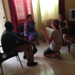 Joni, along with her translator Phillip, sharing the Gospel with a lady in her home